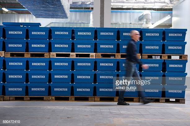 A man walks past boxes with Birkenstock shoes produced at the Alsa GmbH company in Goerlitz eastern Germanyon May 10 2016 / AFP / dpa / Arno Burgi /...