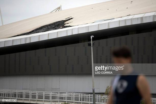 A man walks past Brazil's Olympic velodrome in Rio de Janeiro Brazil on November 26 2017 The already damaged Olympic Velodrome caught fire overnight...