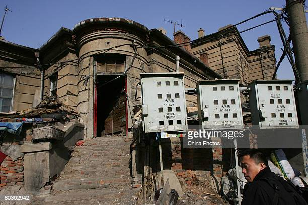 A man walks past buildings of the former Russian Consulate on March 19 2008 in Changchun of Jilin Province China The consulate built in 1904 and...