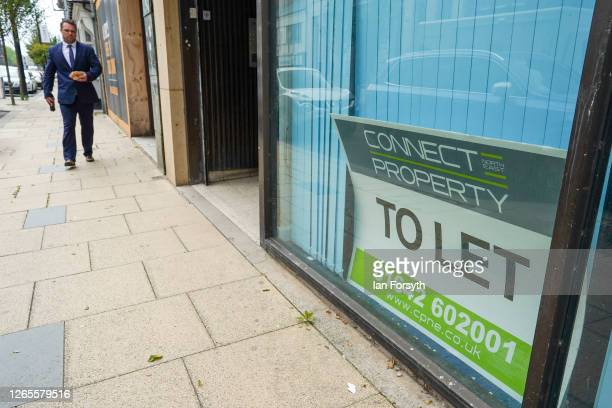 Man walks past buildings offered for let on August 12, 2020 in Middlesbrough, United Kingdom. The Office For National Statistics reported the UK's...