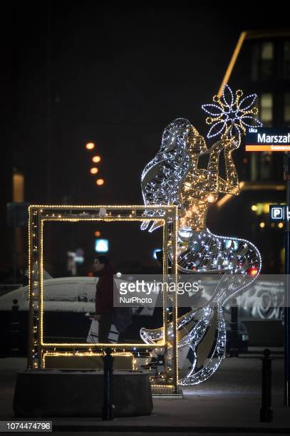 A man walks past Christmas decoration in the center of Warsaw Poland on December 20 2018 Poles this year will spend on average 6 percent more on...