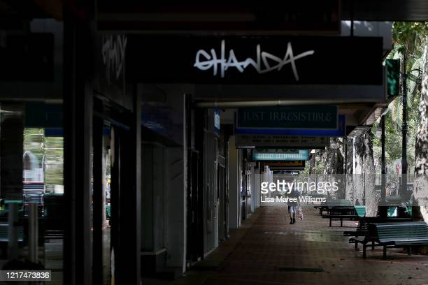 Man walks past closed retail stores along Peel Street on April 04, 2020 in Tamworth, Australia. The Australian government has introduced further...