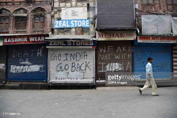 A man walks past closed shops during the restrictions in Srinagar After the revocation of article 370 which gives the special status to Jammu Kashmir...