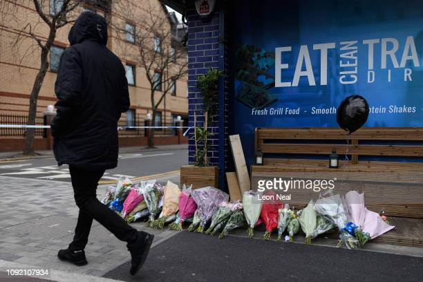 A man walks past floral tributes near to where the murder of Jayden Moody took place on January 09 2019 in London England Jayden Moody was knocked...