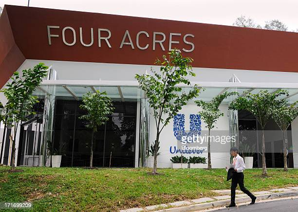 A man walks past Four Acres Unilever Plc's first leadership development center outside the UK in Singapore on Friday June 28 2013 Unilever sees a...