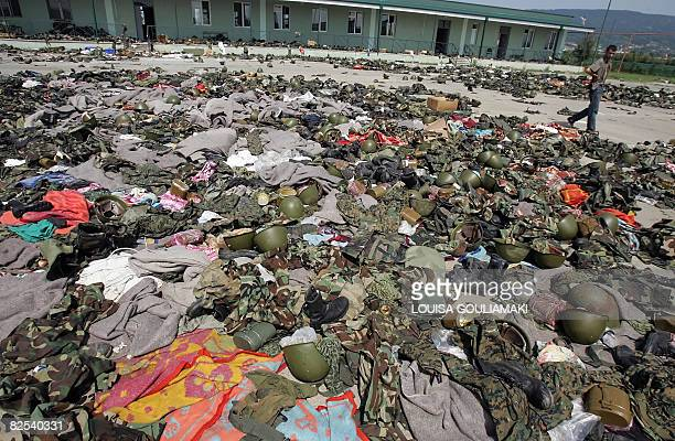 A man walks past Georgian army uniforms after Russian troops left the Georgian army barracks at the military airbase in Senaki on August 23 2008...