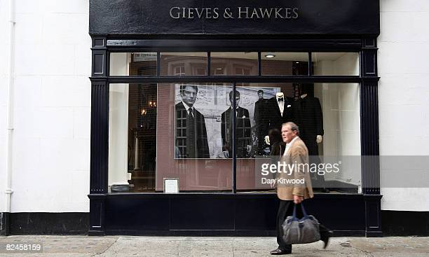 A man walks past Gieves and Hawkes at No 1 Savile Row on August 18 2008 in London England A bespoke two piece suit takes up to eight weeks to make...