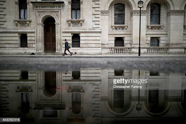 PA man walks past government buildings in Whitehall as David Cameron holds his first cabinet meeting since Brexit on June 27 2016 in London England...
