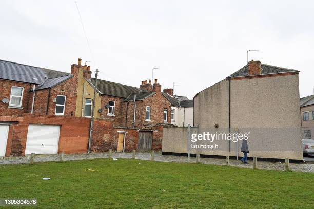 Man walks past homes in Darlington after it was announced by the Chancellor of the Exchequer Rishi Sunak that the town will become the Treasury's new...