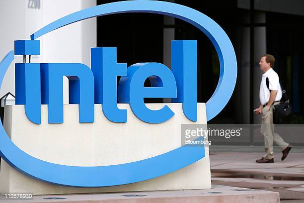A man walks past Intel Corp signage displayed outside of the company's headquarters in Santa Clara California US on Tuesday April 19 2011 Intel Corp...
