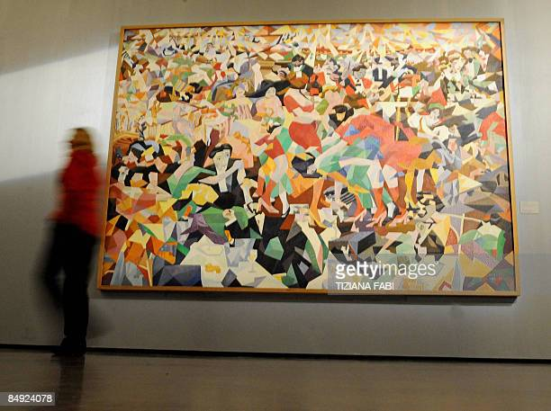 A man walks past Italian artist Gino Severini's painting Pan Pan Dance at Monico on show at the opening of a new exhibition on futurism at the...