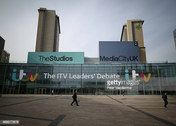 A man walks past ITV studios where an election leaders debate will be broadcast later at Media City on April 2 2015 in Manchester England Tonight...