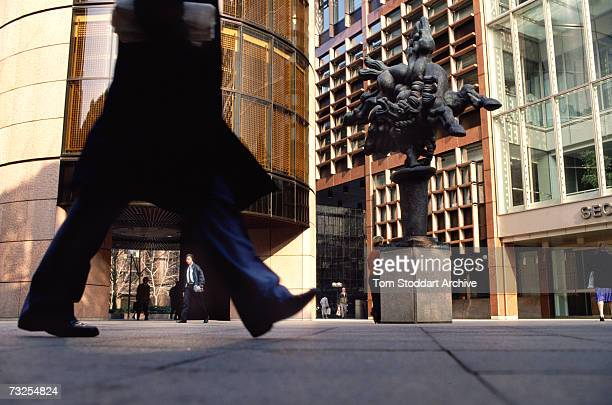 A man walks past Jacques Lipchitz's sculpture 'Bellerophon Taming Pegasus' at Broadgate Circle in the Broadgate office and retail estate in the City...