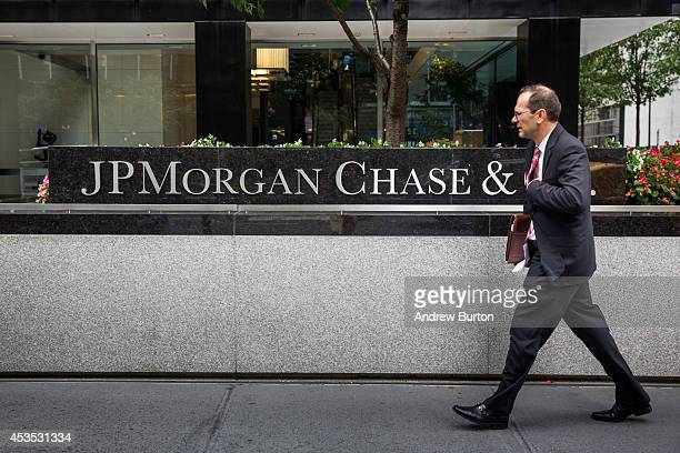 A man walks past JP Morgan Chase's corporate headquarters on August 12 2014 in New York City US banks announced second quarter profits of more than...