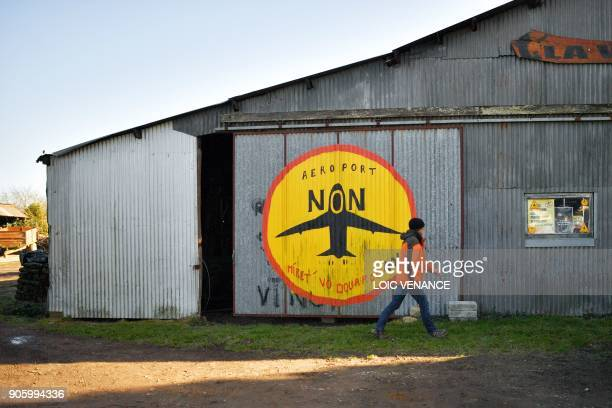 TOPSHOT A man walks past La Vache rit a farm in the 'Zad' of NotreDamedesLandes after French prime minister announced the French government's...