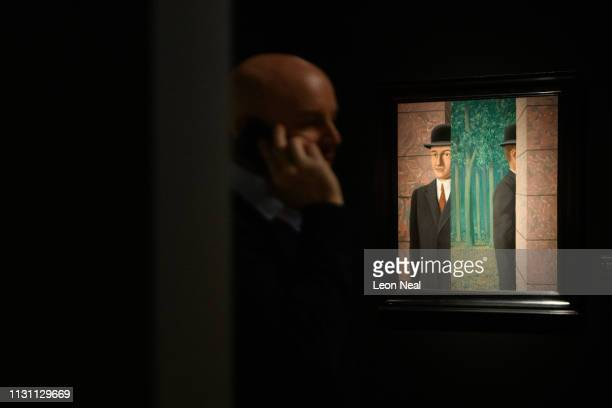 A man walks past Le lieu commun by Rene Magritte during a press preview of the Impressionist and Modern Art sale at Christies on February 21 2019 in...