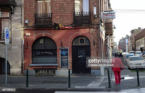 A man walks past Les Beguines owned by Brahim Abdeslam one of the suicide bombers implicated in the Paris attacks on November 17 2015 in Brussels'...