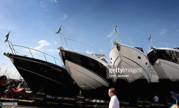 A man walks past new Sunseekers on the first day of the PSP Southampton Boat Show in Mayflower Park on September 11 2009 in Southampton England The...