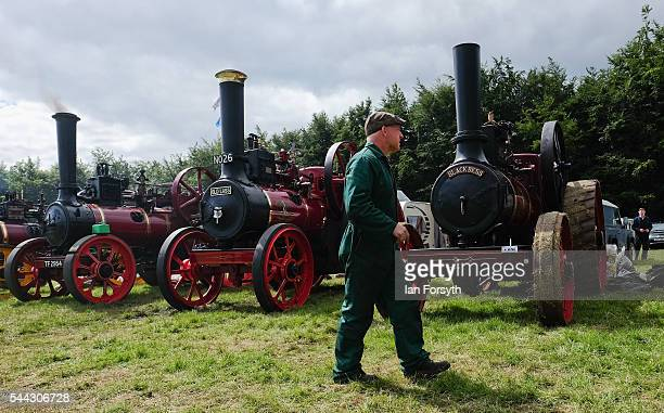 A man walks past of a line of steam engines at the annual Duncombe Park Steam Fair on July 3 2016 in Helmsley England Held in the picturesque grounds...