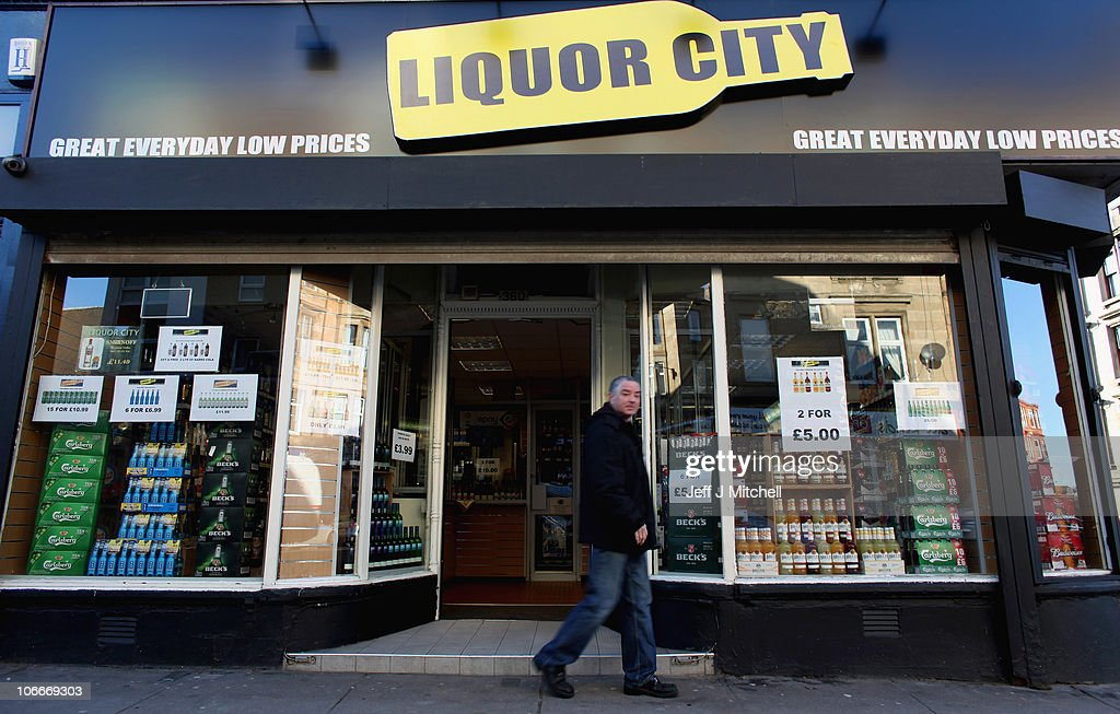 A man walks past offers in an off licence in Duke Street on November 10, 2010 in Glasgow, Scotland. MSP's are set to vote on the SNP government's Alcohol Bill aimed at tackling Scotland's drinking problems. The bill, if it is passed, will see an end to irresponsible drink promotions and will require licensed premises to operate an age verification policy.