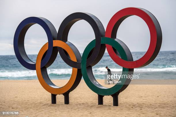 A man walks past Olympic rings on the beach near the Gangneung Coastal Cluster on February 2 2018 in Gangneung South Korea Finishing touches are...