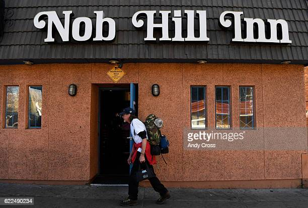 A man walks past on of Denver's oldest bars Nob Hill Inn between Logan and Pennsylvania on Colfax Ave November 11 2016