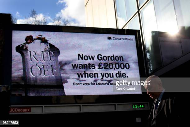 A man walks past one of the Conservative party's new nationwide poster campaigns on February 10 2010 in London United Kingdom As the UK gears up for...