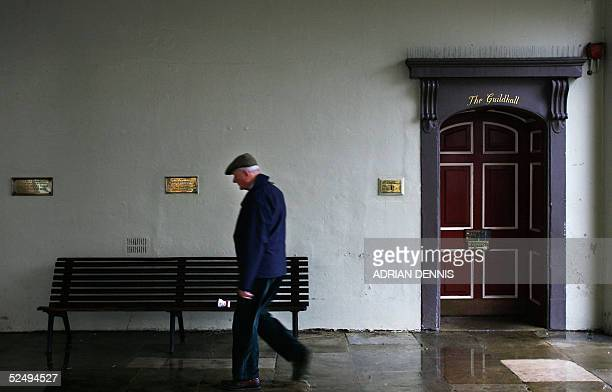 A man walks past one of the entrances to the Windsor Guildhall 30 March where Prince Charles is to marry Camilla Parker Bowles in a private civil...