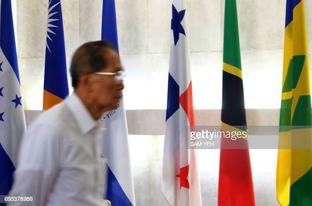 A man walks past Panama's national flag at the Foreign Ministry in Taipei on June 13 2017 Panama and China announced June 13 they were establishing...