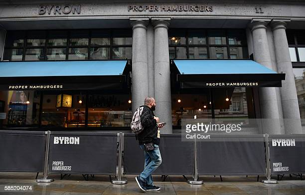 A man walks past past a Byron burger restaurant on August 2 2016 in London England The British restaurant chain are alleged to have organised a...