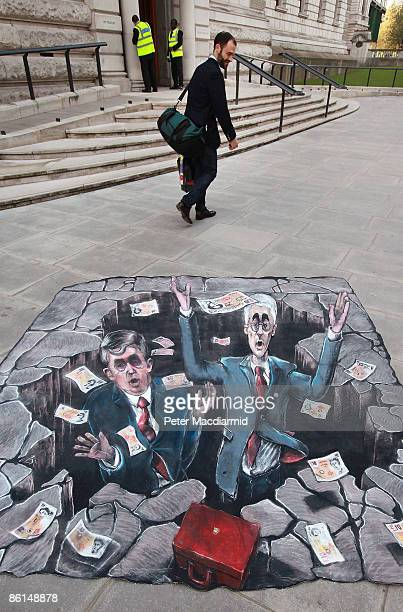 A man walks past piece of street art mounted by Conservative Party activists showing Chancellor Alistair Darling and Prime Minister Gordon Brown in a...