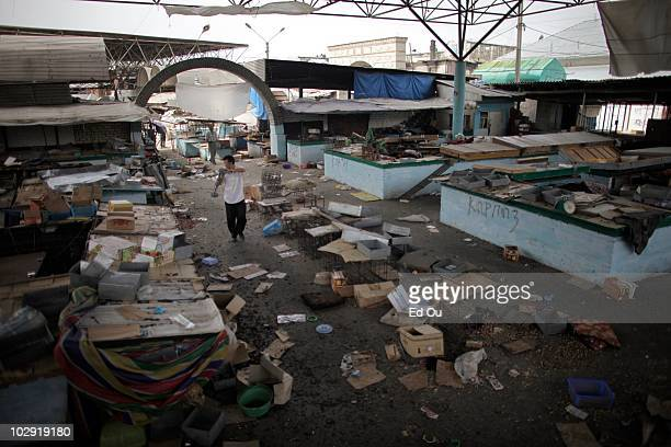 Man walks past pillaged stands in the Osh Bazaar in Osh, Kyrgyzstan June 17, 2010. During last weeks violence between ethnic Uzbeks and Kyrgyz, the...