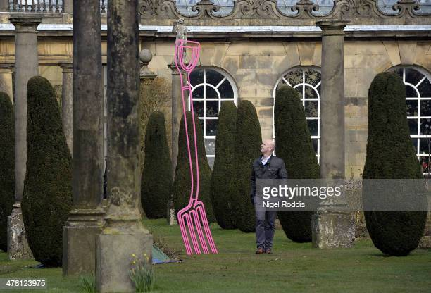 Man walks past Pinkfolk, by artist Michael Craig-Martin, which is part of a new exhibition of his work at Chatsworth House on March 12, 2014 in...