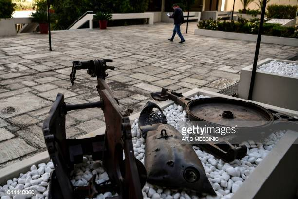 A man walks past remains of a USmade napalm bomb used in the 19441949 Greece's Civil War at the yard of the Greek Communist party compound in Athens...