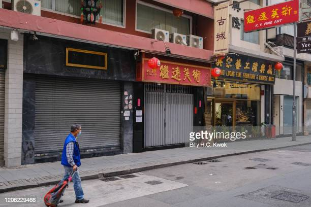 A man walks past some empty stores during a coronavirus outbreak on March 26 2020 in Hong Kong China Latest statistics showed Hong Kong tourist...