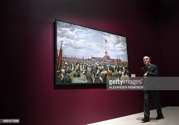 A man walks past Soviet artist Isaak Brodsky's painting Passing of the Banner of the Paris Communards to workers of Moscow on Khodynka in Moscow...