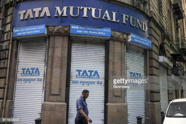 A man walks past Tata Mutual Fund store in Fort area in Mumbai India on Saturday Jan 27 2018 India's economy is expected to grow at 675 percent this...