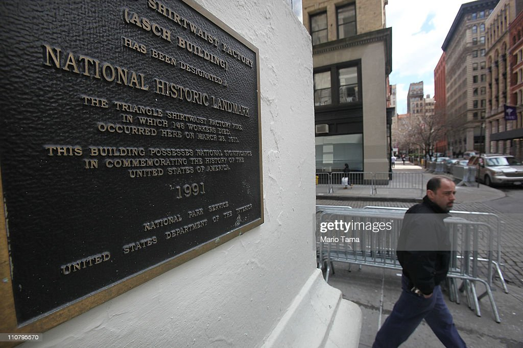 A man walks past the Asch building the day before the 100th anniversary of the infamous Triangle Shirtwaist Factory fire which killed 146 immigrant workers, most of them young women, on March 24, 2011 in New York City. Workers were locked into the factory during their shifts, preventing escape. New Yorkers watched in horror from below as workers leapt to their deaths from the windows above. Public outcry over the tragedy led to nationwide debate on workers rights and safety regulations and helped pave the way for strong workers unions.