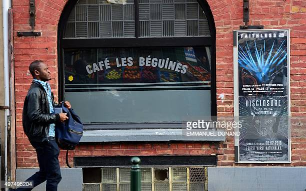 A man walks past the bar Les Beguines owned by Brahim Abdeslam one of the suicide bombers implicated in the Paris attacks on November 17 2015 in...
