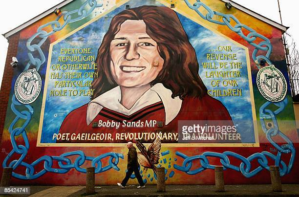 A man walks past the Bobby Sands mural in the Falls road area of Belfast Sands was the first hunger striker to die in the 1981 hunger strike March 14...