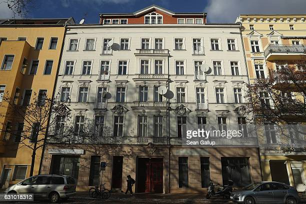 A man walks past the building that houses the former Fussilet 33 mosque in Perleberger Strasse street on January 5 2017 in Berlin Germany According...