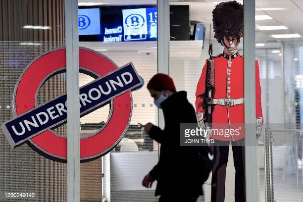 Man walks past the closed entrance of the Eurostar terminal at Brussels South railway station , in Brussels, on December 21, 2020 after Britain's...