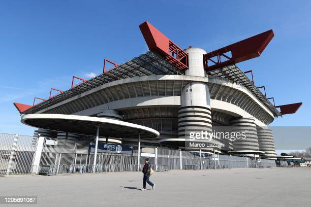 Man walks past the closed stadium after rules to limit the spread of Covid-19 have been put in place before the Serie A match between AC Milan and...