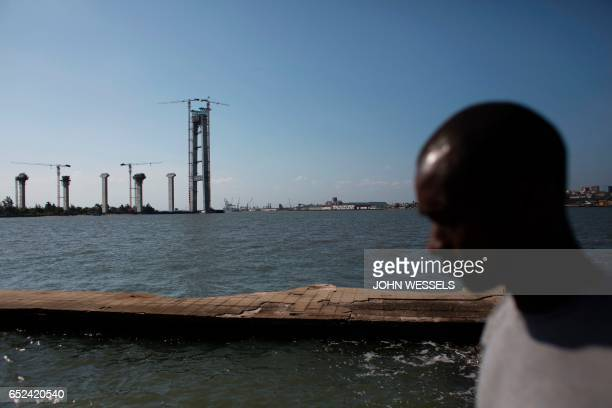 Man walks past the construction site of the Maputo-Catembe Bridge, which will be the longest suspension bridge in Africa, in Maputo on February 9,...