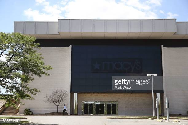 A man walks past the empty Macy's store at the closed Landmark Mall on August 9 2017 in Alexandria Viginia Malls across America are struggling to...