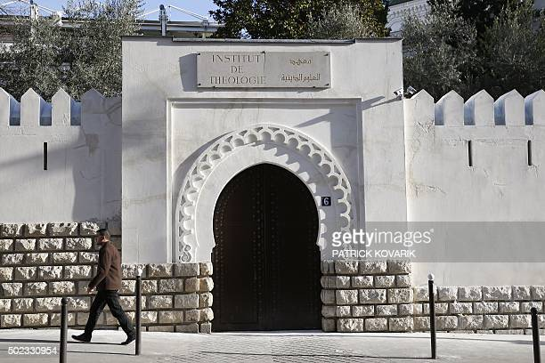 A man walks past the entrance to the AlGhazali theology institute of the Grand Mosque of Paris on December 19 2015 / AFP / PATRICK KOVARIK