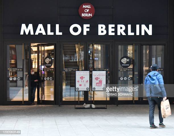Man walks past the entry to a shopping mall in Berlin on April 1 amid the novel coronavirus / COVID-19 pandemic and just before the Easter holidays.