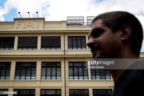 A man walks past the Fiat historic building 'Lingotto' that now is a Fiat Chrysler Automobiles headquarters On July 21 FCA board discuss succession...
