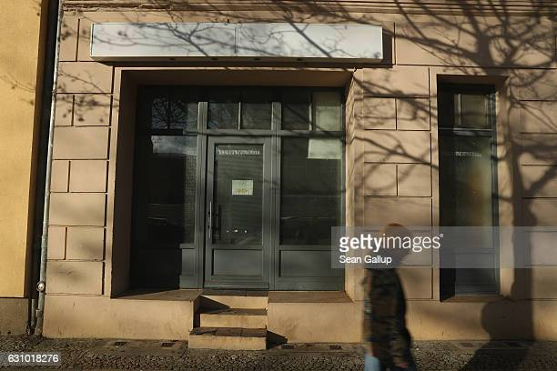 A man walks past the former Fussilet 33 mosque in Perleberger Strasse street on January 5 2017 in Berlin Germany According to police Anis Amri the...