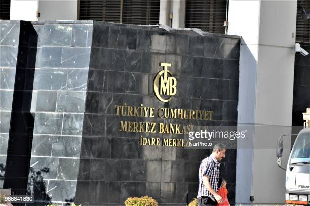 Man walks past the head office of the Central Bank of the Republic of Turkey in Ankara on May 27, 2018.